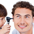Little boy playing with the doctor - Stock Photo