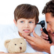 Concentrated doctor examining patient's ears — Stock Photo #10296700