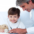 Cute Little boy playing with his doctor — Stock Photo
