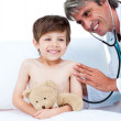 Stock Photo: Adorable little boy attending a medical check-up