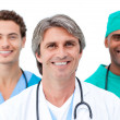 Stock Photo: Positive doctors smiling at the camera