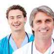 Confident doctors smiling at the camera — Stock Photo #10296768