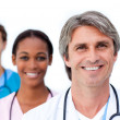 Assertive medical team standing — Stock Photo #10296789