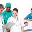 Stock Photo: Smiling medical team in a patient's bedroom