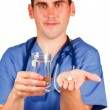 Doctor holding a pill and a glass of water — Stock Photo #10296798