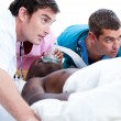 Concentrated medical team resuscitating a patient — Stock Photo #10296878