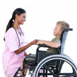 Stock Photo: Ciute little boy in wheelchair discussing with his doctor
