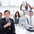 Happy businessteam celebrating a success in office - Stock Photo