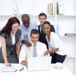 Business team working together with a laptop — Stock Photo #10296940