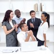 Business team applauding a collegue in office — Stock Photo