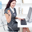 Royalty-Free Stock Photo: Businesswoman holding an apple in office