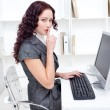 Young businesswoman asking for silence - Stock Photo