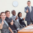 Businessteam with thumbs up after a presentation - Stockfoto