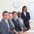 Stockfoto: Businesswomreporting to sales figures to her colleagues