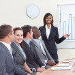 Stock Photo: Indibusinesswomreporting to finance graphs