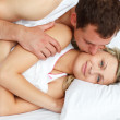 Boyfriend kissing his girlfriend in bed — Stock Photo #10297060