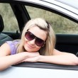Stock Photo: Beautiful young female driver wearing sunglasses