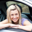 Portrait of a happy young female driver — Stock Photo