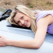 Jolly young driver huging her new car — Stock Photo