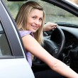 Stock Photo: Young female driver at wheel