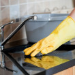 Stock Photo: Close-up of womcleaning kitchen