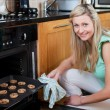 Happy woman baking cookies — Stock Photo #10297171