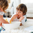 Cute children eating chips and drawing — Stock Photo #10297403