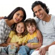 Portrait of a smiling family sitting — Stock Photo