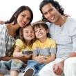 Cheerful family watching TV together — Stockfoto