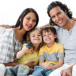 Lively family watching TV  together - Foto Stock