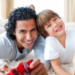 Royalty-Free Stock Photo: Animated little boy and his father playing video games