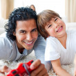 Animated little boy and his father playing video games - Foto Stock