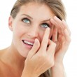 Attractive blond woman putting a contact lens — Stock Photo #10297480
