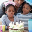 Cute little girl and her family celebrating her birthday - Foto Stock