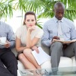 Bored business sitting on sofwaiting for interview — Stock Photo #10297750