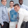 Stock Photo: Busines standing around water cooler