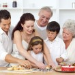 Parents, grandparents and children baking in the kitchen — Stock Photo #10297917