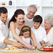 Parents, grandparents and children baking in the kitchen — Stock Photo