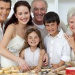 Portrait of parents, grandparents and children baking in the kit — Stock Photo