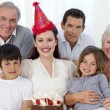 Stock Photo: Grandparents, parents and children celebrating a birthday