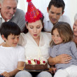 Happy family celebrating mother's birthday — Stock Photo