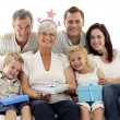 Family celebrating grandmother's birthday - Stock Photo