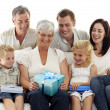 Family giving a gift to grandmother — Stock Photo #10297993