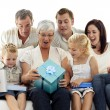 Family opening presents in grandmother's birthday — Stock Photo