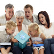 Family giving a present to grandmother — Stock Photo #10297997