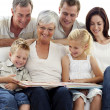 Stock Photo: Happy family observing photograph album