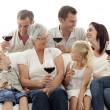 Family having a celebration with wine and eating biscuits — Stockfoto