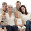 Happy family watching television in living-room — Stok fotoğraf