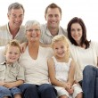 Portrait of family on sofa — Stock Photo #10298022