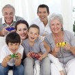 Family having fun playing video games — Stock Photo #10298053